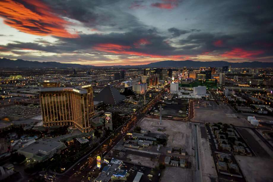 Hotels stand on The Strip in this aerial photograph taken at dusk above Las Vegas, Nevada. Photo: Bloomberg Photo By David Paul Morris. / © 2015 Bloomberg Finance LP