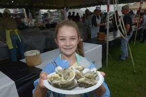Caitlin Janecka, 12, enjoys Copps Island Oysters during The Norwalk Seaport Association 41st Annual Oyster Festival Saturday, September 8, 2018, at Veterans Memorial Park in Norwalk, Conn.