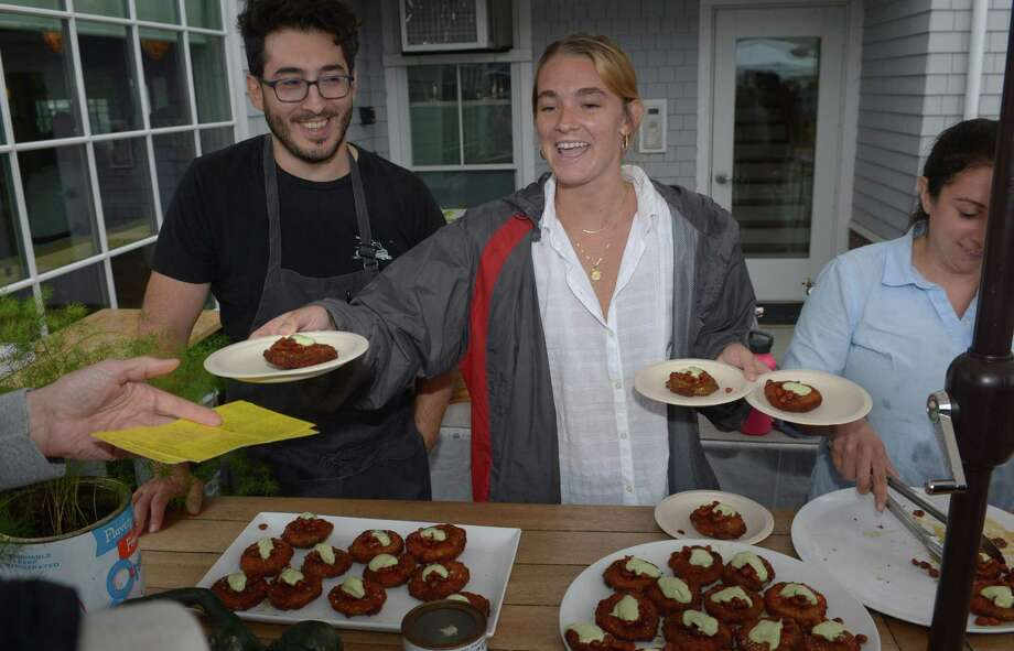 Whelk chef Anthonyy Kosilis and server Morgan Mahoney serve up fried green tomatoes during The 7th Annual Slice of Saugatuck Food Tasting and Retail Experience on Saturday September 8, 2018, in the Saugatuck neighborehood in Westport, Conn. After highly successful events starting in 2011 the Slice returns for the seventh year with over four dozen of Saugatuck's finest restaurants, shops and galleries opening their doors and inviting the community to come and sample their offerings. Photo: Erik Trautmann / Hearst Connecticut Media / Connecticut Post