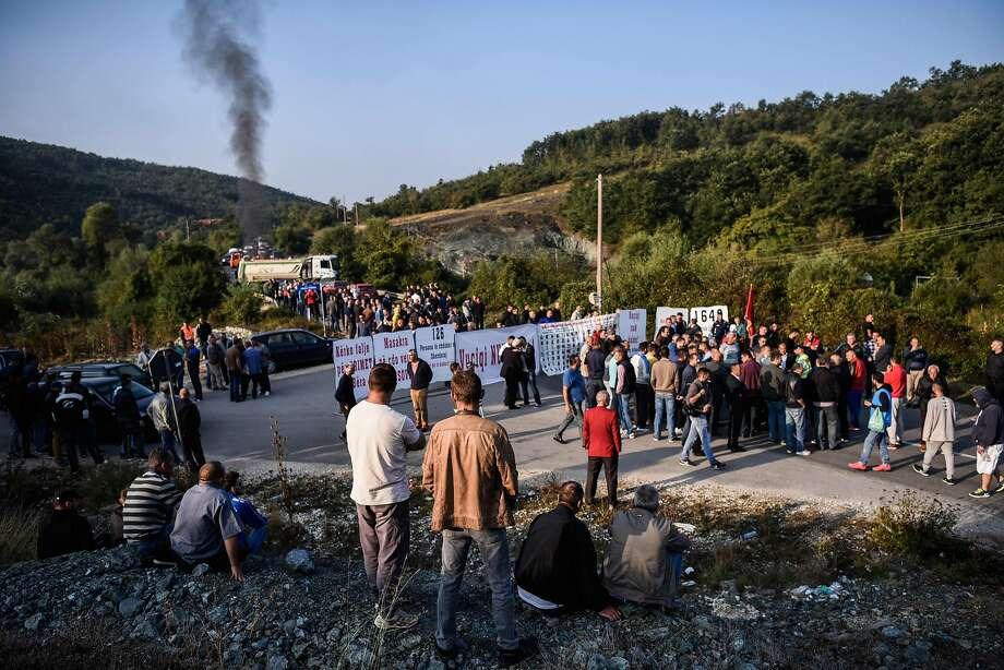 Kosovo Albanians gather around a barricade as they block on September 9, 2018 access to a village due to be visited by Serbian President, on the main road between Mitrovica, in the north of Kosovo, and the village of Banje, a Serbian enclave some 60 kilometres (40 miles) away, as a festering row over Kosovo independence clouds hopes that the war foes can normalise relations. (Photo by Armend NIMANI / AFP)ARMEND NIMANI/AFP/Getty Images Photo: ARMEND NIMANI;Armend Nimani / AFP / Getty Images