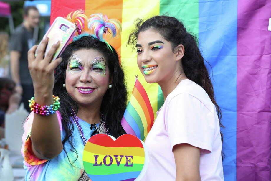 Giovanna Guzmán and her daughter (same name) Giovanna Guzmán shoot a selfie during The Woodlands Pride Festival - Presented by Comcast in Town Green Park Saturday, Sept. 8, 2018, in The Woodlands. Photo: Steve Gonzales, Staff Photographer / © 2018 Houston Chronicle