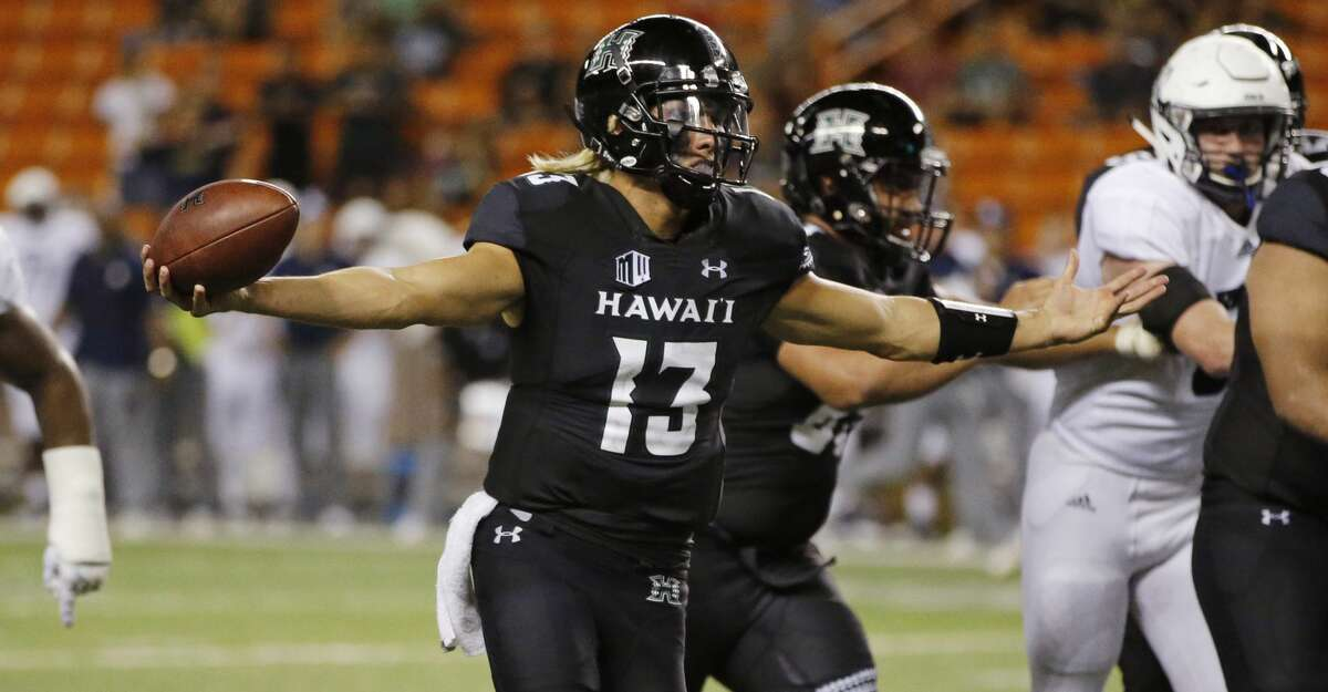 Hawaii quarterback Cole McDonald (13) makes a two-point conversion against Rice during the fourth quarter at an NCAA college football game Saturday, Sept. 8, 2018, in Honolulu. (AP Photo/Marco Garcia)