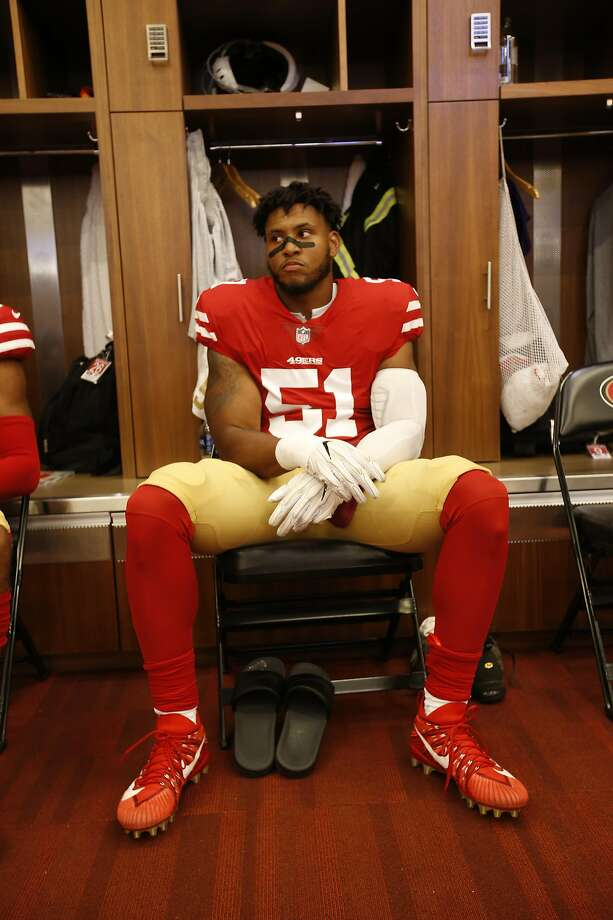 Malcolm Smith #51 of the San Francisco 49ers sits in the locker room prior to the game against the Dallas Cowboys at Levi Stadium on August 9, 2018 in Santa Clara, California. Smith will sit out Sunday's game against the Vikings. Photo: Michael Zagaris / Getty Images