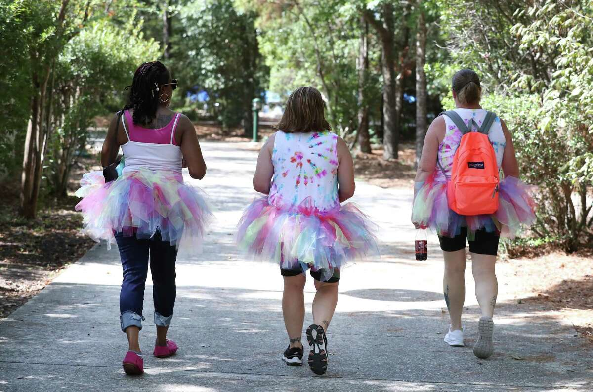 A trio of tutu wearers make their way to The Woodlands Pride Festival - Presented by Comcast in Town Green Park Saturday, Sept. 8, 2018, in The Woodlands.