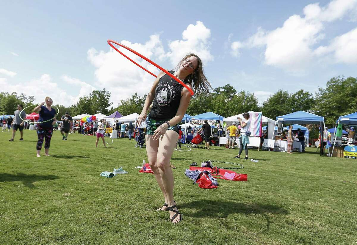 Fran Koiner, a hoop dance teacher for Inner Space Hooping, takes part in a hooping event during The Woodlands Pride Festival - Presented by Comcast in Town Green Park Saturday, Sept. 8, 2018, in The Woodlands.