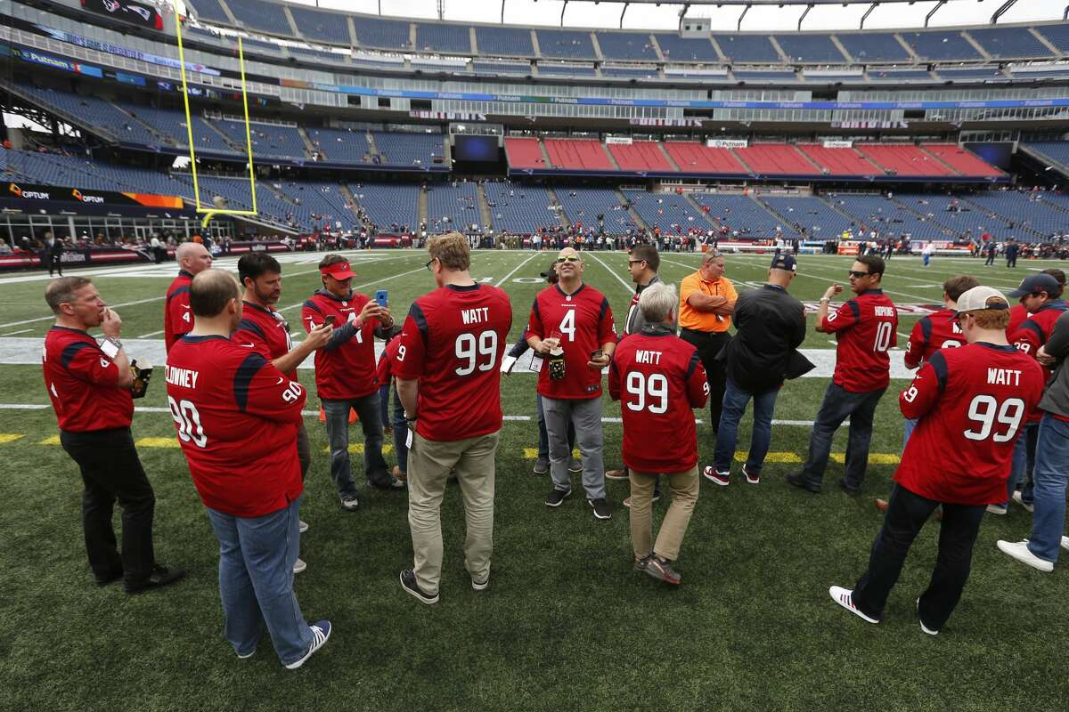 A group of Houston Texans fans take in warm ups on the sidelines before an NFL football game against the New England Patriots at Gillette Stadium on Sunday, Sept. 9, 2018, in Foxborough, Mass.