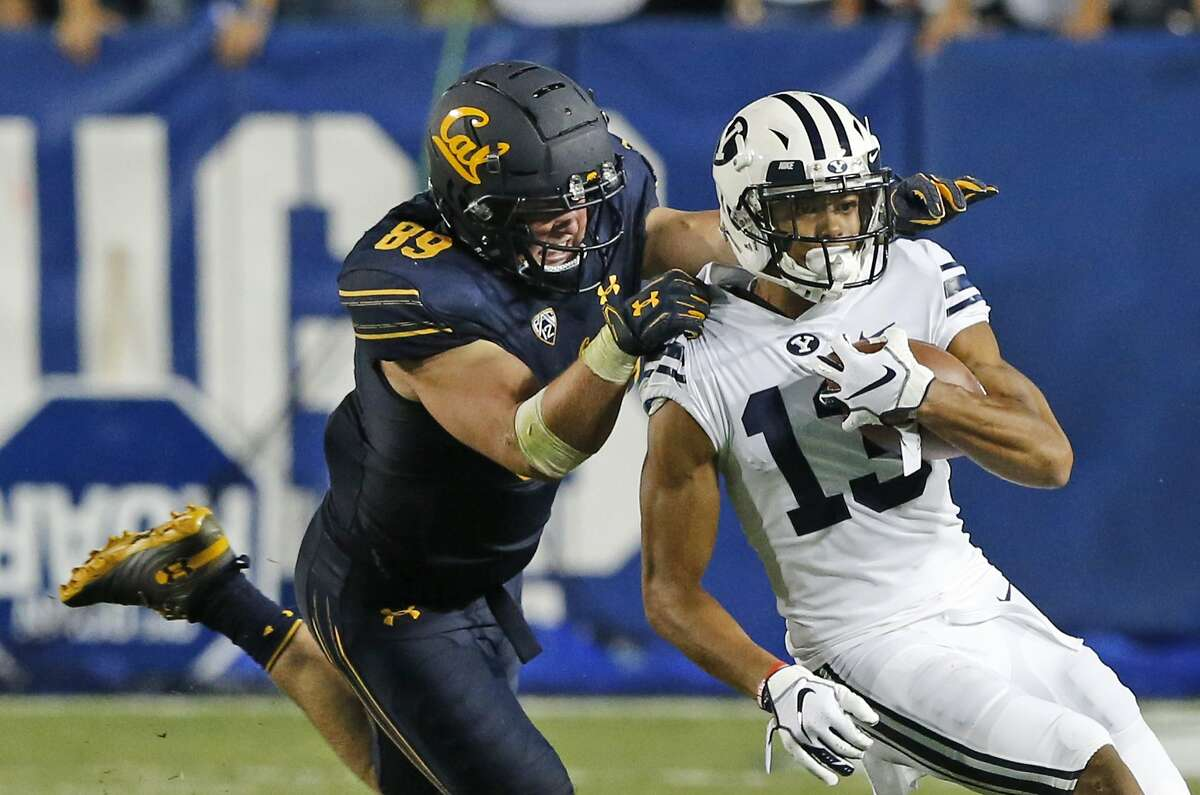 California linebacker Evan Weaver (89) tackles BYU wide receiver Micah Simon (13) in the second half during an NCAA college football game Saturday, Sept. 8, 2018, in Provo, Utah. California won 21-18. (AP Photo/Rick Bowmer)