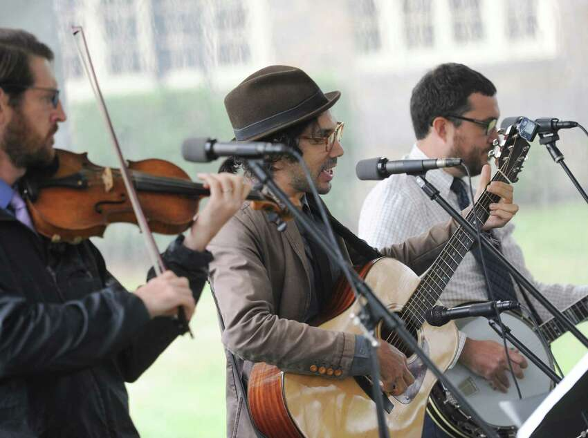 The Astrograss bluegrass band performs at the annual homecoming weekend at Second Congregational Church in Greenwich, Conn. Sunday, Sept. 9, 2018. The church held a special outdoor service featuring music from the Astrograss bluegrass band, a buffet-style feast and games and activities for kids.
