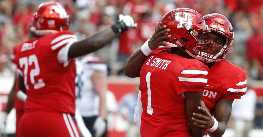 PHOTOS: UH vs. Arizona Houston Cougars Bryson Smith (1) celebrates his touchdown during the first half of a college football game at TDECU Stadium, Saturday, September 8, 2018, in Houston. Browse through the photos to see action from UH's win over Arizona on Sept. 8. Photo: Karen Warren/Staff Photographer