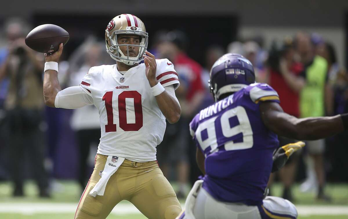 San Francisco 49ers quarterback Jimmy Garoppolo throws a pass over Minnesota Vikings defensive end Danielle Hunter (99) during the second half of an NFL football game, Sunday, Sept. 9, 2018, in Minneapolis. (AP Photo/Jim Mone)
