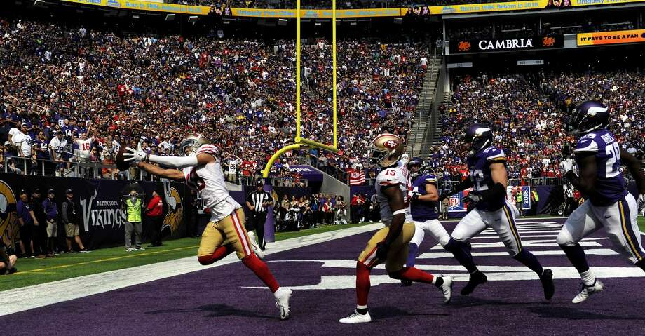 MINNEAPOLIS, MN - SEPTEMBER 09: Dante Pettis #18 of the San Francisco 49ers catches the ball for a touchdown in the third quarter of the game against the Minnesota Vikings at U.S. Bank Stadium on September 9, 2018 in Minneapolis, Minnesota. (Photo by Hannah Foslien/Getty Images) Photo: Hannah Foslien/Getty Images