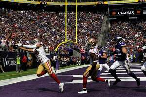 MINNEAPOLIS, MN - SEPTEMBER 09: Dante Pettis #18 of the San Francisco 49ers catches the ball for a touchdown in the third quarter of the game against the Minnesota Vikings at U.S. Bank Stadium on September 9, 2018 in Minneapolis, Minnesota. (Photo by Hannah Foslien/Getty Images)