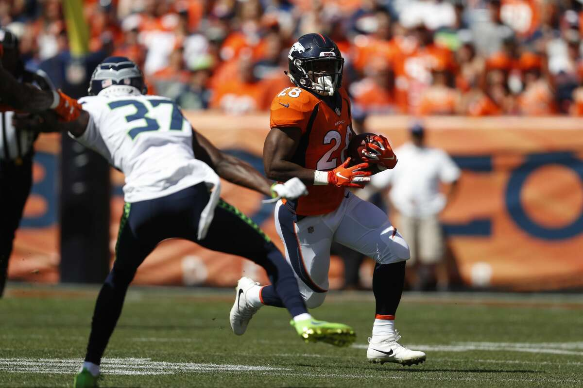 Denver Broncos running back Royce Freeman runs with the ball during the first half of an NFL football game against the Seattle Seahawks Sunday, Sept. 9, 2018, in Denver. (AP Photo/David Zalubowski)