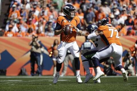 d470096526f <p>Denver Broncos quarterback Case Keenum throws a pass during the first  half of