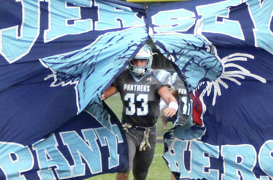 Jersey senior Kurt Hall breaks through the banner welcoming the Panthers to the field before Thursday's against Centralia at the Snyders Sports Complex in Jerseyville. Hall rushed for 130 yards on 11 carries in the Panthers' 21-14 overtime victory. Photo: Greg Shashack / The Telegraph