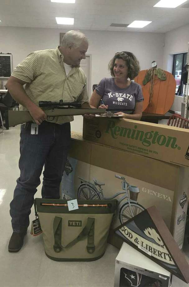 Vice President Scott Perry and Committee Chair Stacey Jata are busy logging in all the Live & Silent Auction items scheduled to be on display for the Conroe Noon Lions Club annual Dinner/Dance & Auction coming up this Thursday night.