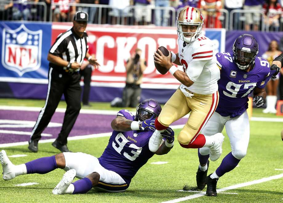 San Francisco 49ers quarterback Jimmy Garoppolo, center, is sacked by Minnesota Vikings defensive tackle Sheldon Richardson (93) and defensive end Everson Griffen (97) during the first half of an NFL football game, Sunday, Sept. 9, 2018, in Minneapolis. (AP Photo/Bruce Kluckhohn) Photo: Bruce Kluckhohn, Associated Press