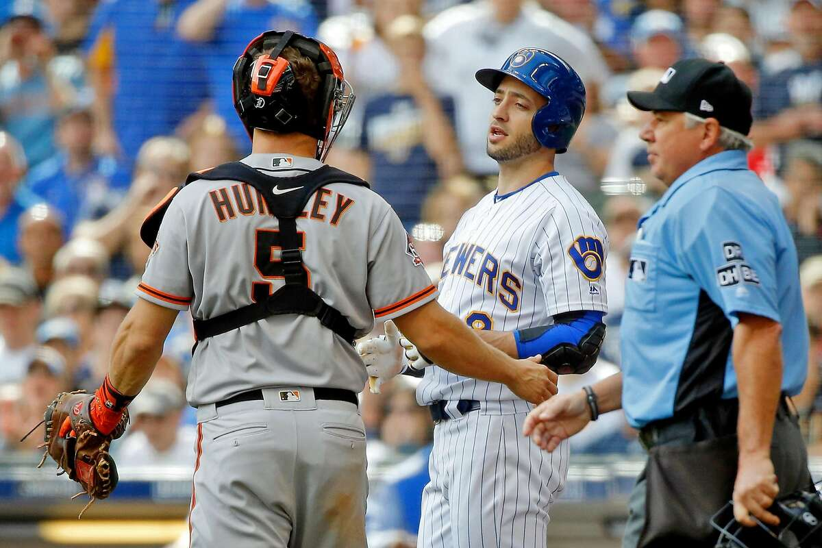 MILWAUKEE, WI - SEPTEMBER 09: Ryan Braun #8 of the Milwaukee Brewers talks with Nick Hundley #5 of the San Francisco Giants after he was hit by a pitch thrown by Madison Bumgarner #40 (not pictured) to load the bases during the sixth inning at Miller Park on September 9, 2018 in Milwaukee, Wisconsin. (Photo by Jon Durr/Getty Images)