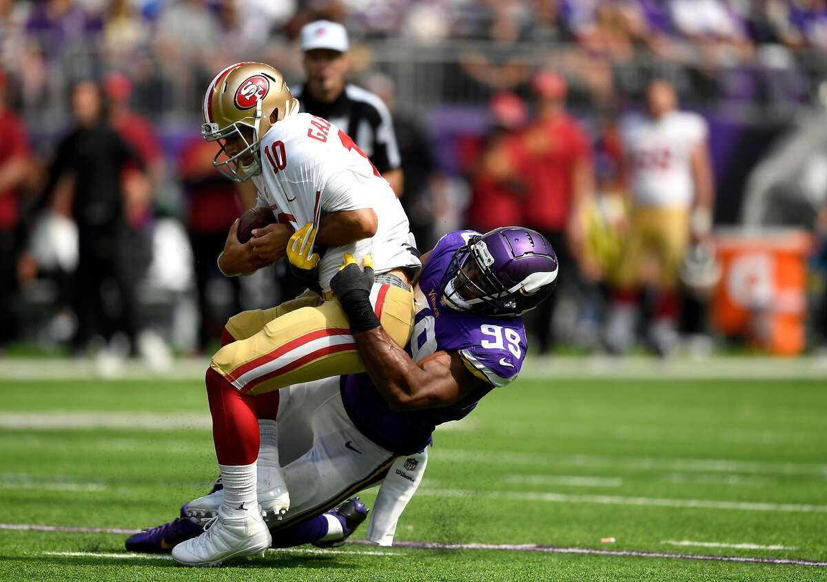 Danielle Hunter #99 of the Minnesota Vikings sacks Jimmy Garoppolo #10 of the San Francisco 49ers in the second half of the game at U.S. Bank Stadium on September 9, 2018 in Minneapolis, Minnesota. (Photo by Hannah Foslien/Getty Images)