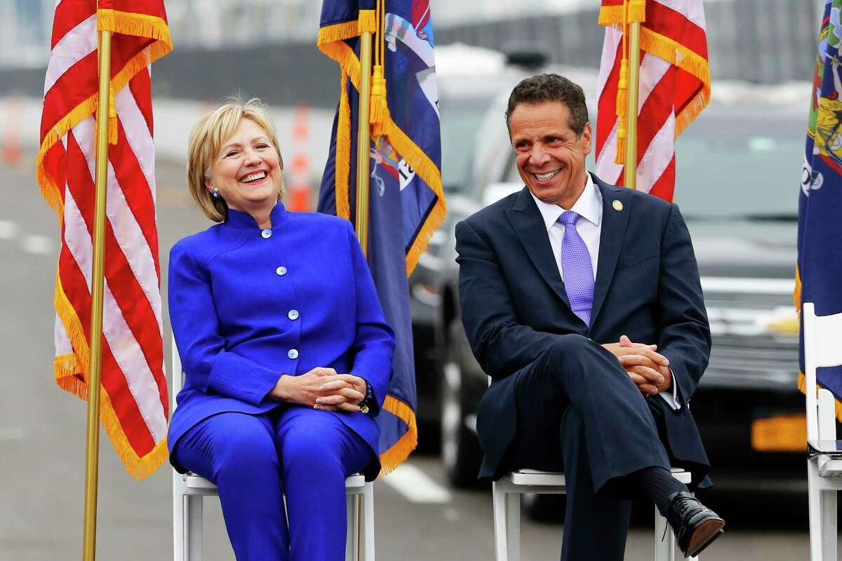 Former Secretary of State Hillary Clinton, left, sits with New York Gov. Andrew Cuomo for the officially opening of the Gov. Mario M. Cuomo Bridge, Friday, Sept. 7, 2018, in Nyack, N.Y. The new bridge's first span opened last year, when the structure was named to honor Mario Cuomo, governor from 1983 to 1994, and Andrew Cuomo's father.