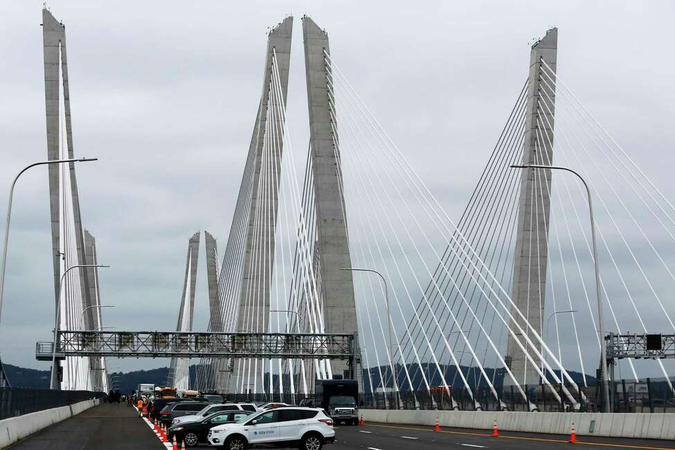 Cars are parked on the Gov. Mario M. Cuomo Bridge during its official opening, Friday, Sept. 7, 2018, in Nyack, N.Y. The new bridge's first span opened last year, when the structure was named to honor Mario Cuomo, New York's governor from 1983 to 1994 and father of the state's current chief executive, Andrew Cuomo.