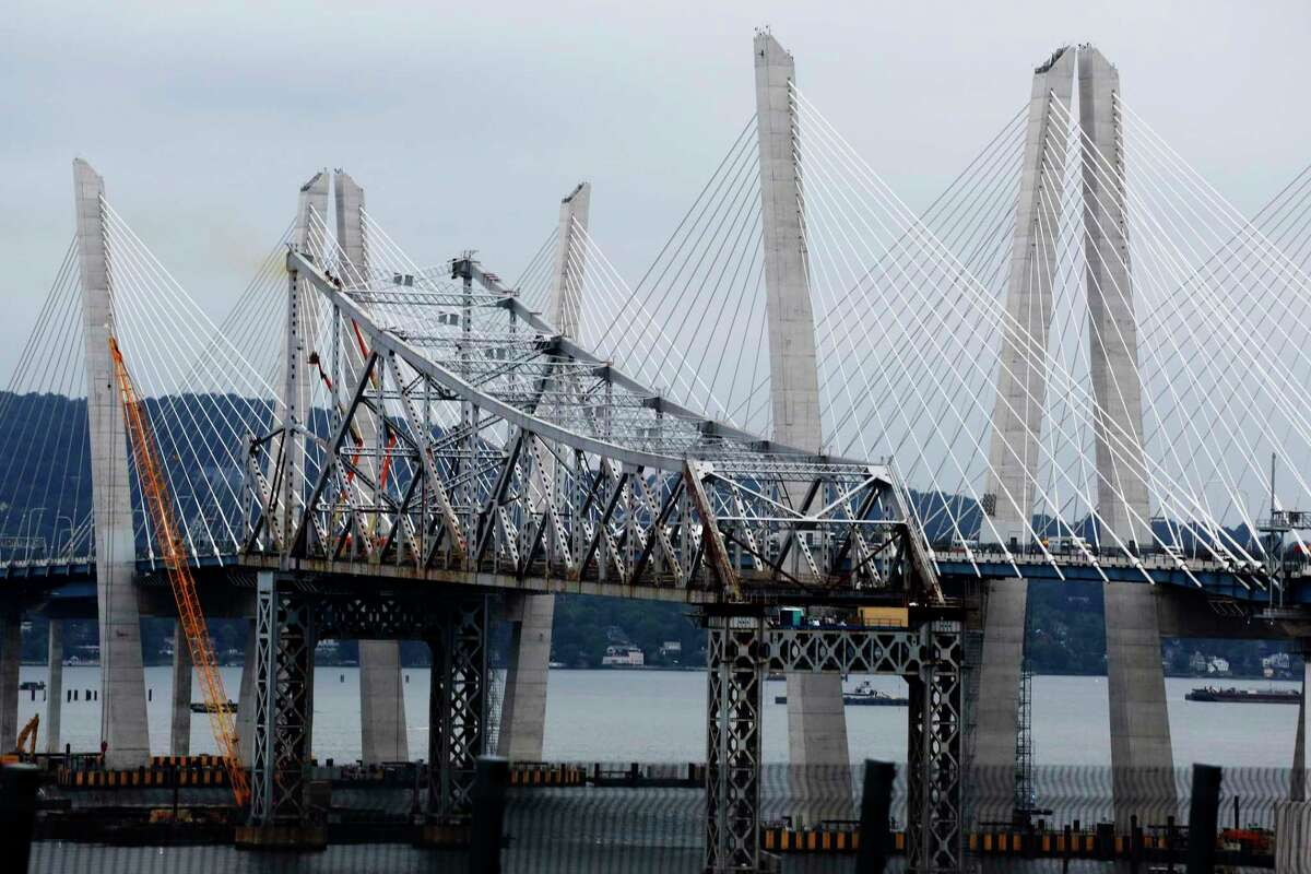 A portion of the old Tappan Zee Bridge, center, is framed by the Gov. Mario M. Cuomo Bridge, Friday, Sept. 7, 2018, in Nyack, N.Y. The bridge linking Westchester and Rockland counties over the Hudson River replaces the Tappan Zee Bridge, most of which has been demolished.