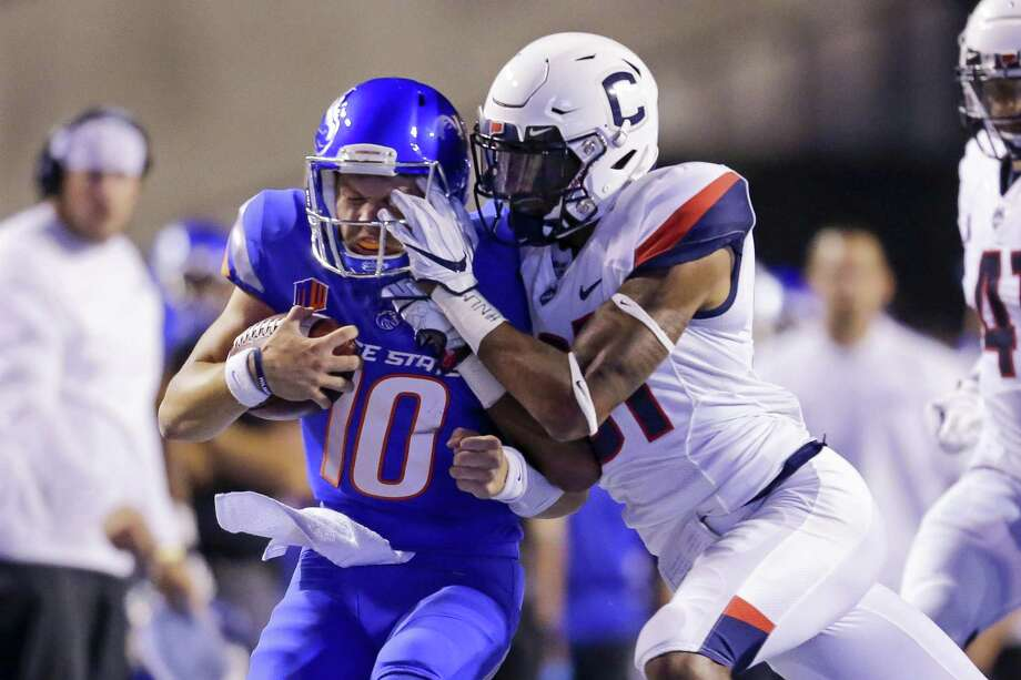 Boise State's Chase Cord (10) is hit by UConn's Oneil Robinson during Saturday's game. Photo: Steve Conner / Associated Press / Copyright 2018 The Associated Press. All rights reserved.