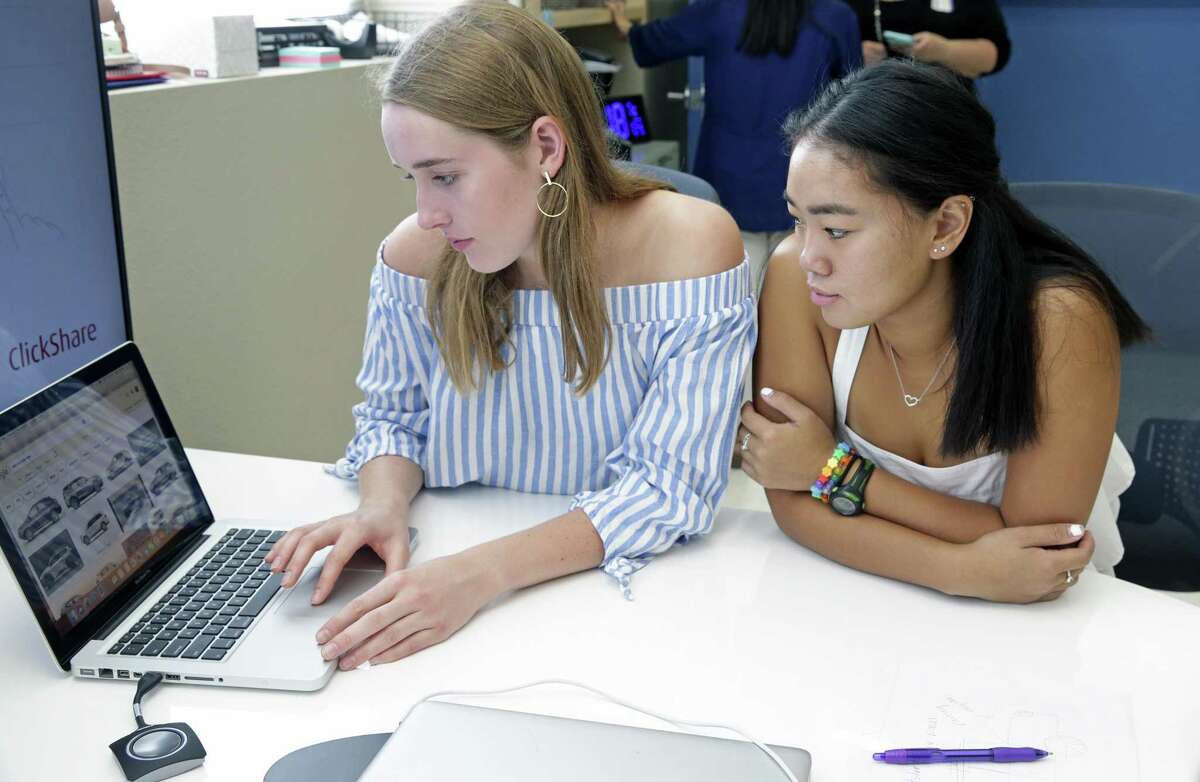 Helen Hunter (left) and Mia McEwen check the internet for ideas as Alamo Heights students participate in a class called Business Incubator wherein groups work on a business presentation and present it to real business people visiting the school on September 5, 2018.