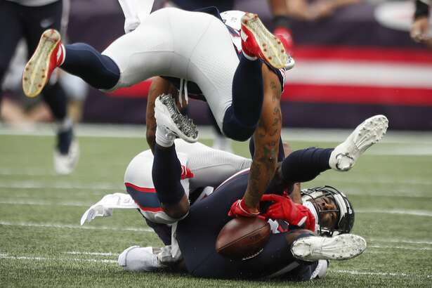 New England Patriots defensive backs Patrick Chung and Jonathan Jones (31) break up a pass intended for Houston Texans wide receiver Bruce Ellington (12) during the fourth quarter of an NFL football game at Gillette Stadium on Sunday, Sept. 9, 2018, in Foxborough, Mass.