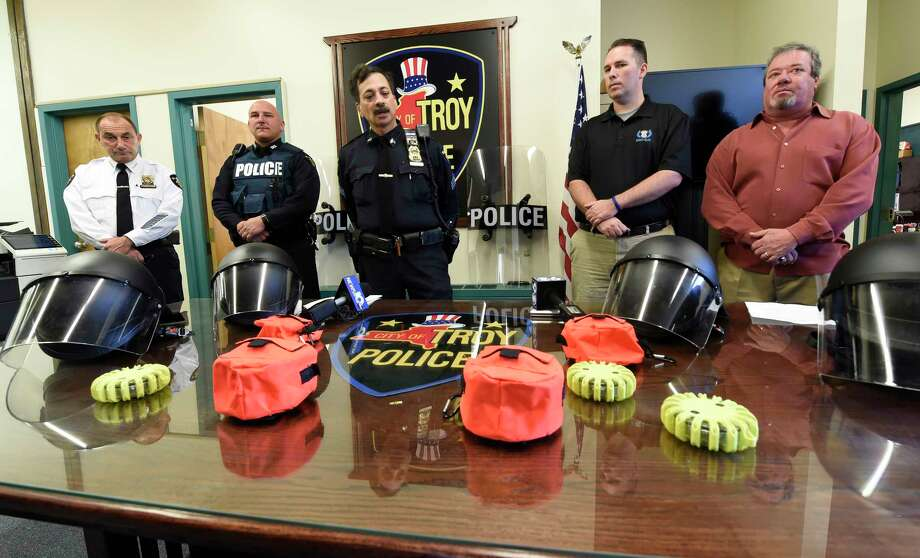 Troy Police Department unveiled new riot and safety gear during a press conference at their headquarters Monday morning Nov. 16, 2015, in Troy, N.Y. Attending the presentation of the equipment are, from left; Troy Chief John Tedesco, Officer Dominick Comitale, Sgt. Sam Carello and Ryan T. Smith, executive director of Spirit of Blue. The gear was derived from a grant from the Spirit of Blue program with the help of the Dunkin' Donuts Corporation (Skip Dickstein/Times Union) Photo: SKIP DICKSTEIN, ALBANY TIMES UNION / 00034257A