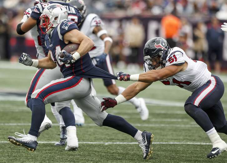 New England Patriots running back Rex Burkhead (34) pulls away from Houston Texans linebacker Dylan Cole (51) for a first down during the third quarter of an NFL football game at Gillette Stadium on Sunday, Sept. 9, 2018, in Foxborough, Mass.