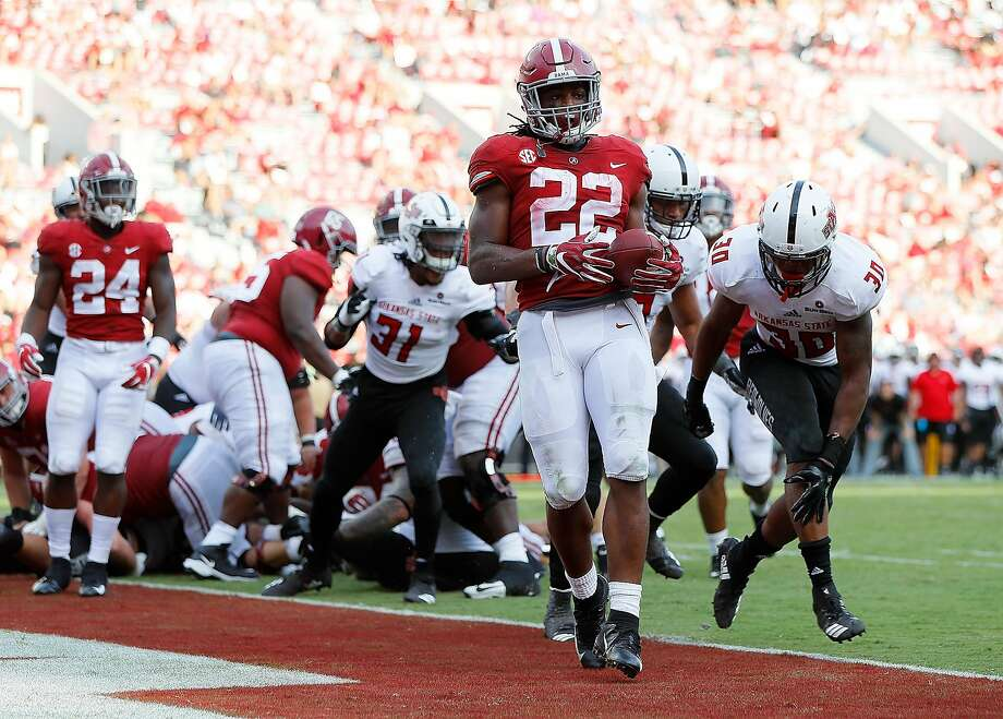 TUSCALOOSA, AL - SEPTEMBER 08:  Najee Harris #22 of the Alabama Crimson Tide rushes in for a touchdown past B.J. Edmonds #3 and Derrick Bean #30 of the Arkansas State Red Wolves at Bryant-Denny Stadium on September 8, 2018 in Tuscaloosa, Alabama.  (Photo by Kevin C. Cox/Getty Images) Photo: Kevin C. Cox / Getty Images
