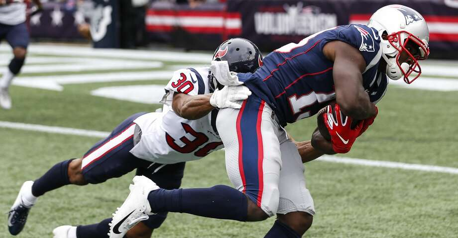 PHOTOS: Texans vs. Patriots New England Patriots wide receiver Phillip Dorsett (13) makes a catch near the goal line against Houston Texans cornerback Kevin Johnson (30) during the second quarter of an NFL football game at Gillette Stadium on Sunday, Sept. 9, 2018, in Foxborough, Mass. Browse through the photos to see action from the Texans' season opener at New England. Photo: Brett Coomer/Staff Photographer