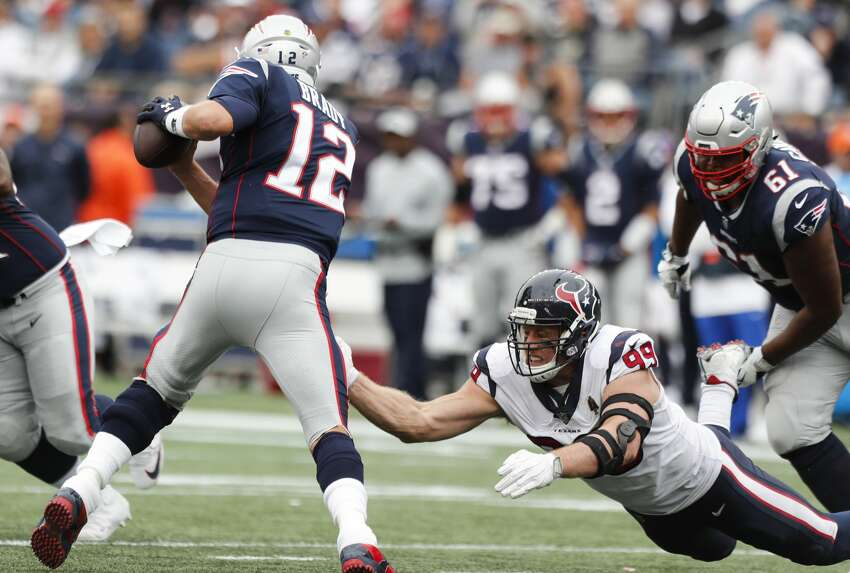 New England Patriots quarterback Tom Brady (12) dodges Houston Texans defensive end J.J. Watt (99) and avoids a sack during the third quarter of an NFL football game at Gillette Stadium on Sunday, Sept. 9, 2018, in Foxborough, Mass.