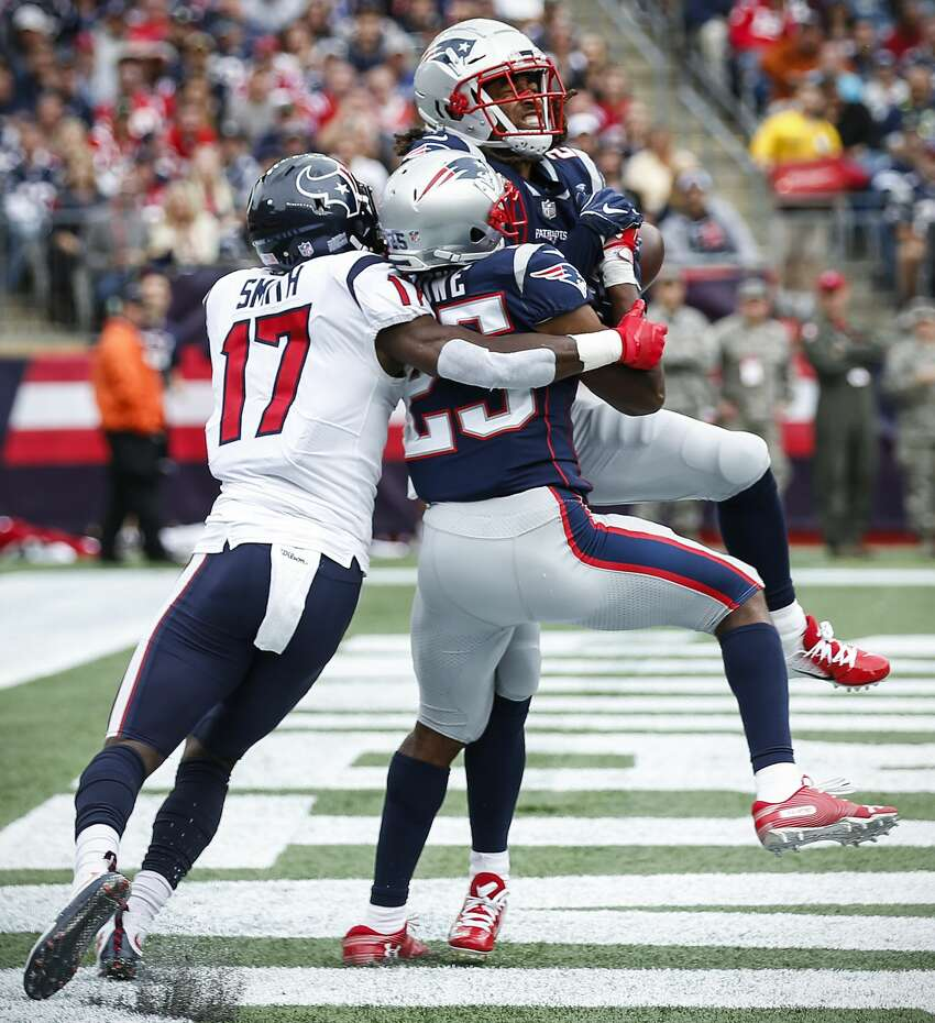 New England Patriots defensive back Eric Rowe (25) intercepts a pass in the end zone intended for Houston Texans wide receiver Vyncint Smith (17) during the second quarter of an NFL football game at Gillette Stadium on Sunday, Sept. 9, 2018, in Foxborough, Mass.