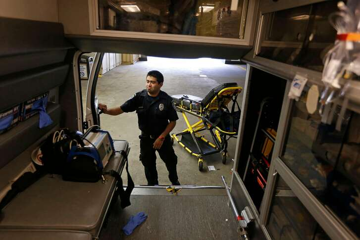Paramedic Cory Yeo with the King-American Ambulance company, preps their ambulance at the California Pacific Medical Center, after a medical call, in San Francisco, Calif., on Thursday 12, 2014. A report by the San Francisco Supervisor's budget analyst reports the city needs to increase its ambulance staffing, improve its emergency system coordination and 911 dispatch system and replace it's aging ambulance fleet.