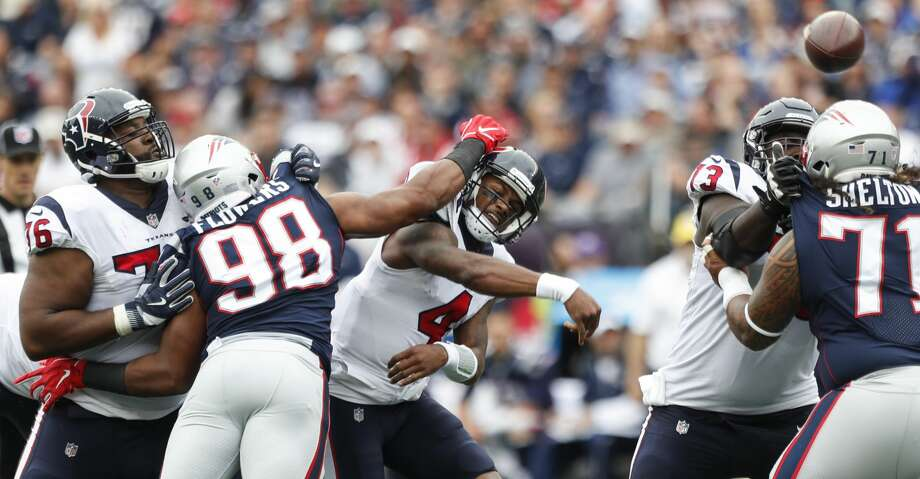 Houston Texans quarterback Deshaun Watson (4) is hit by New England Patriots defensive end Keionta Davis (58) and defensive end Trey Flowers (98) as he tries to throw a pass during the first quarter of an NFL football game at Gillette Stadium on Sunday, Sept. 9, 2018, in Foxborough, Mass. The pass fell incomplete. Photo: Brett Coomer/Staff Photographer
