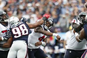 Houston Texans quarterback Deshaun Watson (4) is hit by New England Patriots defensive end Keionta Davis (58) and defensive end Trey Flowers (98) as he tries to throw a pass during the first quarter of an NFL football game at Gillette Stadium on Sunday, Sept. 9, 2018, in Foxborough, Mass. The pass fell incomplete.