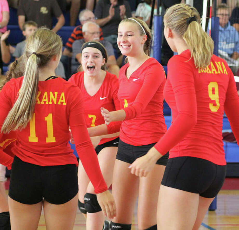 Roxana's Macie Lucas (middle right) celebrates a point with teammates Taylor Jackson, Abby Kurth (11) and Abi Stahlhut (9) during the Roxana Tournament on Aug. 25 at Milazzo Gym in Roxana. Lucas was named to the Montgomery County Tournament's all-tourney team Saturday after leading the Shells to a third-place finish. Photo: Greg Shashack / The Telegraph