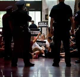 Demonstrators chant outside Sen. Chuck Grassley�s office before being arrested, during Judge Brett Kavanaugh's Supreme Court confirmation hearing on Capitol Hill in Washington, Sept. 6, 2018. (Erin Schaff/The New York Times)