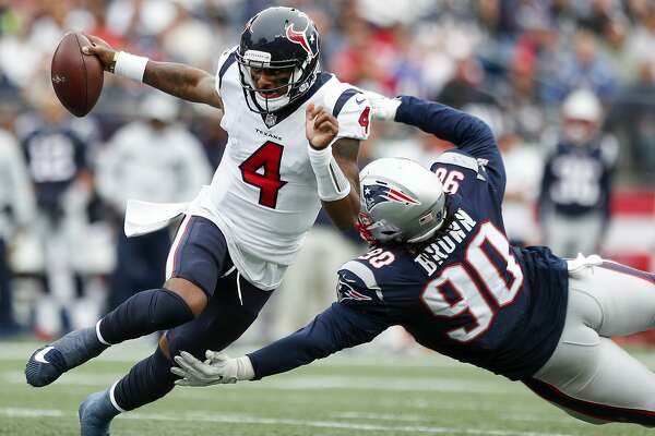 Houston Texans quarterback Deshaun Watson (4) runs out of the pocket away from New England Patriots defensive tackle Malcom Brown (90) to avoid a sack during the fourth quarter of an NFL football game at Gillette Stadium on Sunday, Sept. 9, 2018, in Foxborough, Mass.
