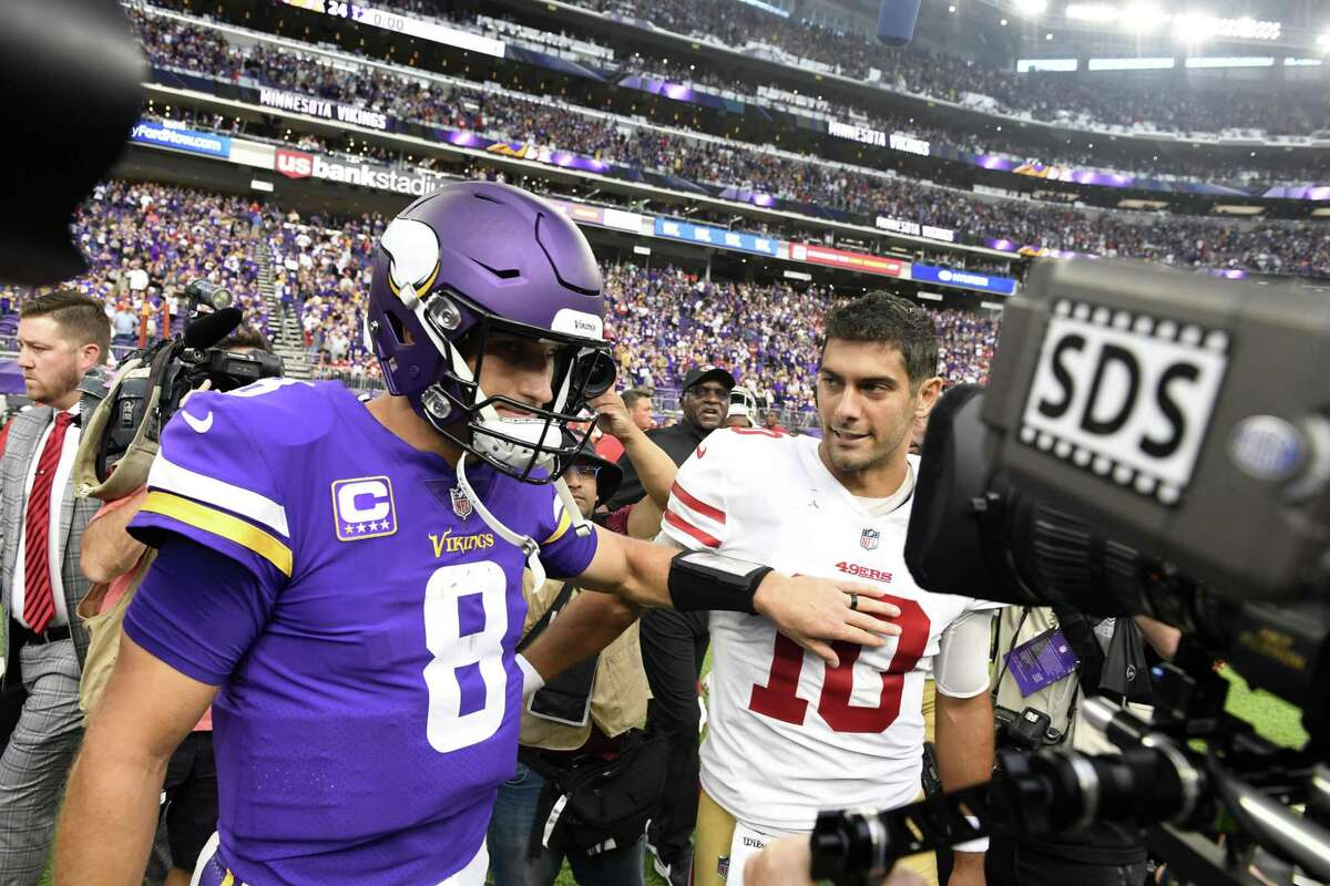 Kirk Cousins #8 of the Minnesota Vikings and Jimmy Garoppolo #10 of the San Francisco 49ers greet each other on the field after the game at U.S. Bank Stadium on September 9, 2018 in Minneapolis, Minnesota. The Vikings defeated the 49ers 24-16. (Photo by Hannah Foslien/Getty Images)