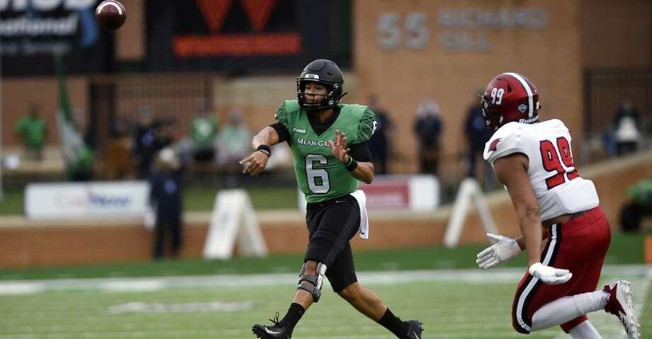 North Texas quarterback Mason Fine (6) throws a pass against Incarnate Word during an NCAA college football game Saturday, Sept. 8, 2018, in Denton, Texas. (Jake King/The Denton Record-Chronicle via AP) Photo: Jake King/Associated Press