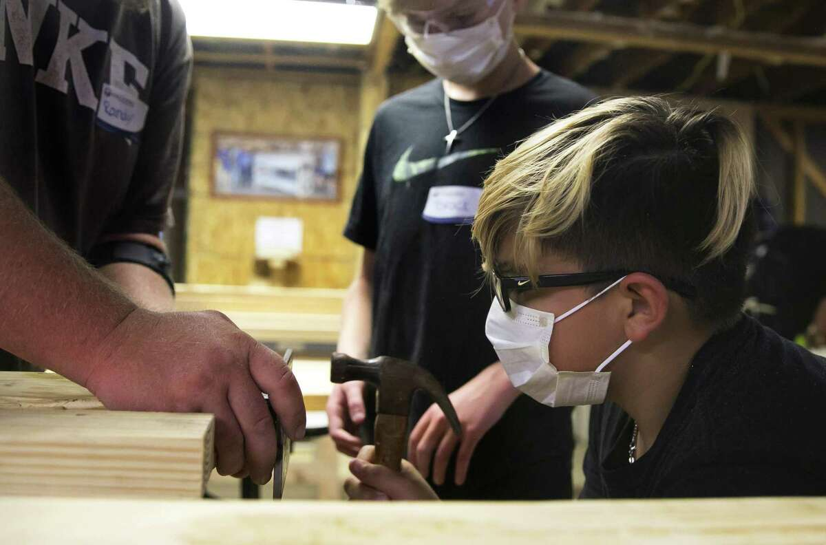 Eleven-year-old Jason Lopez helps with the construction of 40 beds (20 bunk beds) during the second bunk bed build of the Northwest Houston Chapter of the Sleep in Heavenly Peace organization on Saturday, Sept. 8, 2018, in Cypress.
