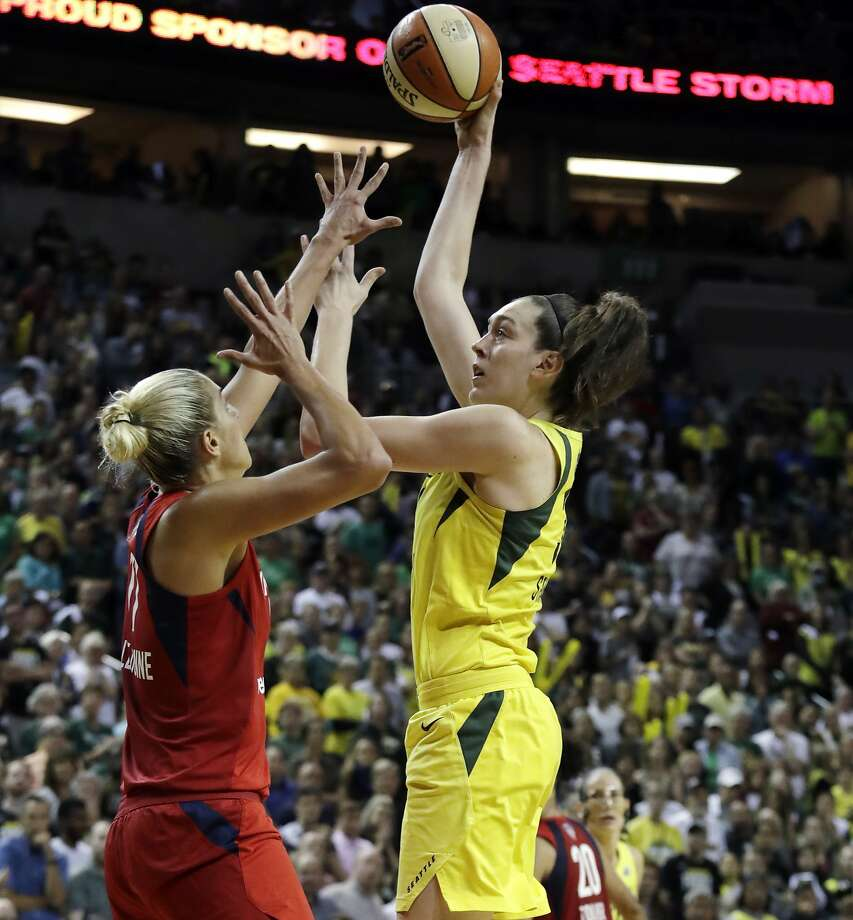 The Seattle Storm's Breanna Stewart shoots over Elena Delle Donne of the Washington Mystics during Game 2 in Seattle. Photo: Elaine Thompson / Associated Press