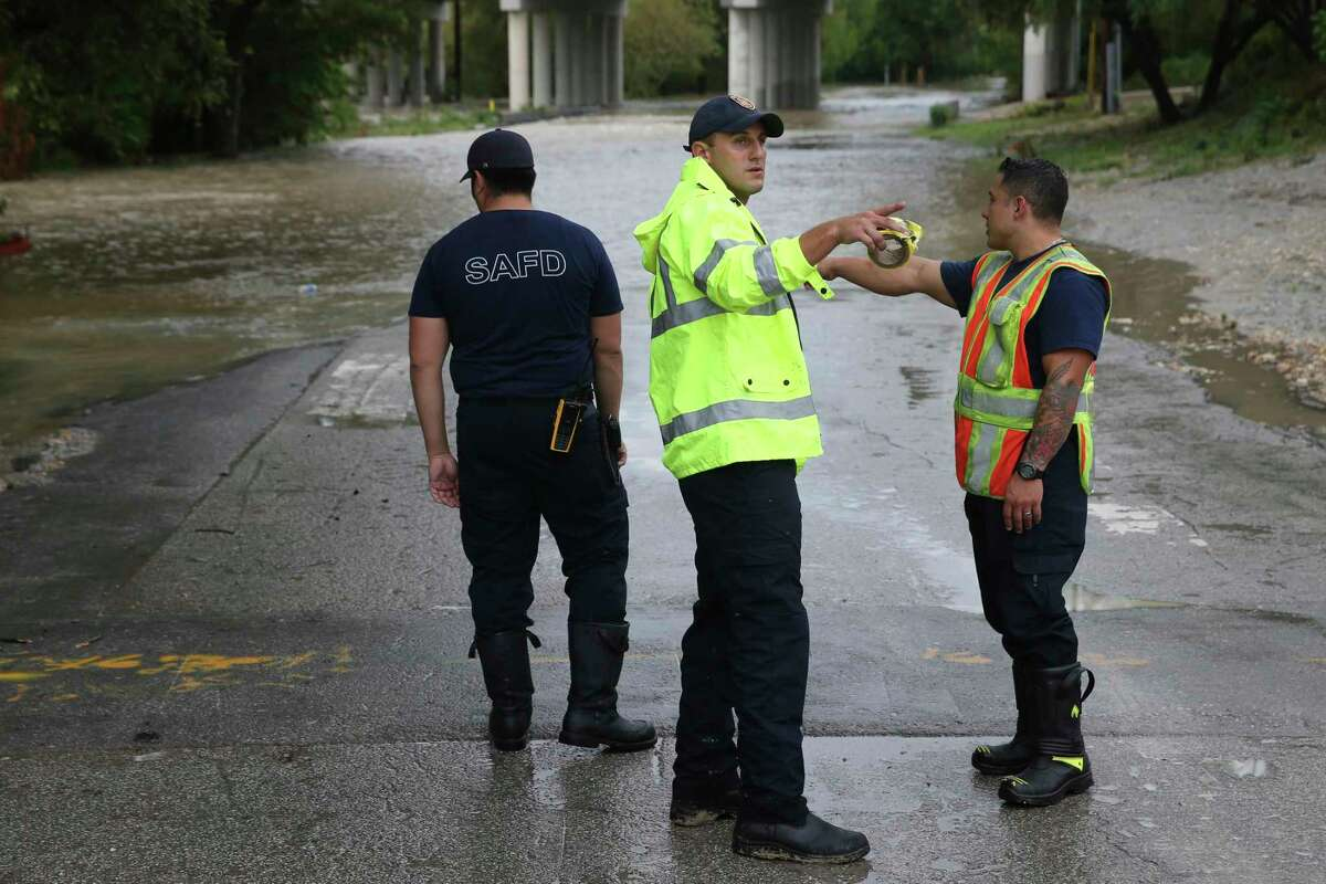 San Antonio Fire Department personnel close off Holbrook at Salado Creek , Sunday, Sept. 9, 2018. Heavy rains caused the closure of over 70 streets in the county.