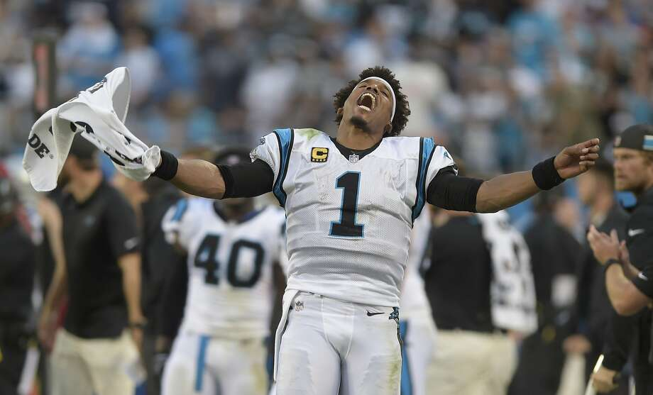 Carolina quarterback Cam Newton celebrates during the second half of the Panthers' 16-8 victory over the Dallas Cowboys. Photo: Mike McCarn / Associated Press