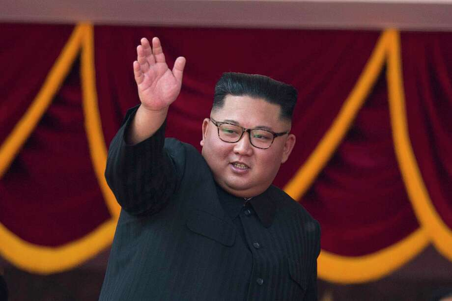 North Korean leader Kim Jong Un waves as he attends a parade marking the 70th anniversary of North Korea's founding day in Pyongyang, North Korea, Sunday, Sept. 9, 2018. North Korea staged a major military parade, huge rallies and will revive its iconic mass games on Sunday to mark its 70th anniversary as a nation. (AP Photo/Ng Han Guan) Photo: Ng Han Guan / Copyright 2018 The Associated Press. All rights reserved.