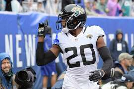Jacksonville Jaguars cornerback Jalen Ramsey (20) gestures to New York Giants' Odell Beckham during the first half of an NFL football game Sunday, Sept. 9, 2018, in East Rutherford, N.J. (AP Photo/Bill Kostroun)