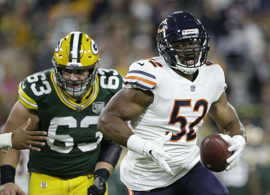 A pick-six by Chicago's Khalil Mack stood to be the play of the night until Green Bay's Aaron Rodgers had his say. Photo: Jeffrey Phelps / Associated Press